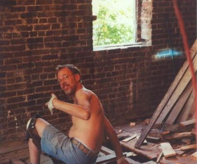 Michael Shenker fixing up his home on East 7th Street in 2003. Photo by Fly.