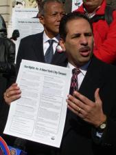 Bronx Councilmember Fernando Cabrera holds an example of the Tenants Bill of Rights at City Hall
