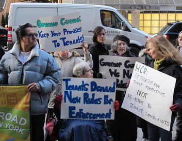 About 50 tenants rallied outside Governor Andrew Cuomo's Midtown office Dec. 13 to demand that the state strengthen and enforce its tenant-protection laws.