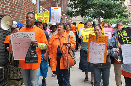 """Chanting """"Repairs now"""" and """"No more fees,"""" Bronx tenants and supporters march up Sheridan Avenue."""