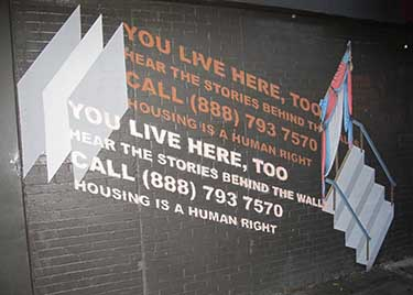 A sign outside the HiARTS gallery in East Harlem recruiting people to tell their stories to We Live Here Too.