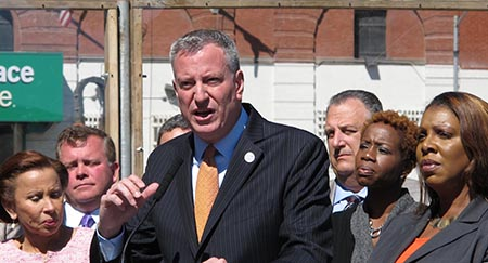 Mayor de Blasio announces plan in Brooklyn May 5, with Public Advocate Letitia James, right.