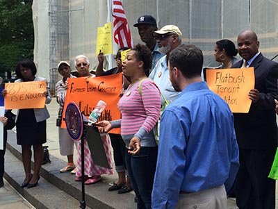 Redoneva Andrews of the Flatbush Tenants Coalition speaks at a City Hall rally June 6.