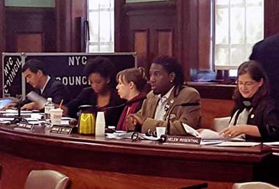 City Council Housing and Buildings Committee chair Jumaane Williams (2nd from right opens Oct. 1 hearing on illegal hotels. Councilmember Ydanis A. Rodriguez is on the left. Councilmember Helen Rosenthal on the right. Photo courtesy of Jumaane Williams Twitter.