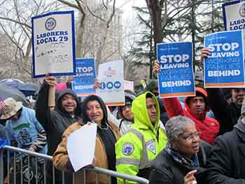 Union workers formed a large part of the crowd outside City Hall Feb. 23. Photo: Steven Wishnia.