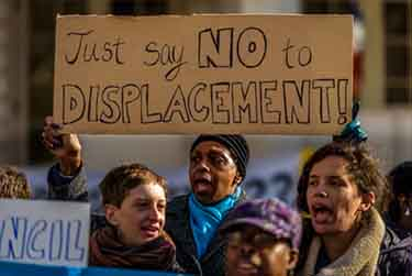 Rally at City Hall before March 22 vote. Photo by Erik McGregor.