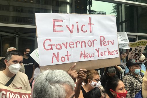 """Tenants protesting Gov. Cuomo hold sign saying """"Evict Governor Perv, Not New Yorkers"""""""