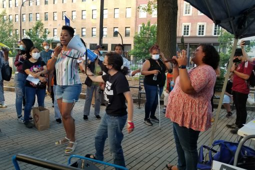 Tenants protest RGB outdoors with megaphone